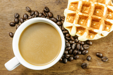 Coffee cup with grains and waffle