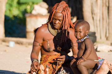 Native Himba woman with son