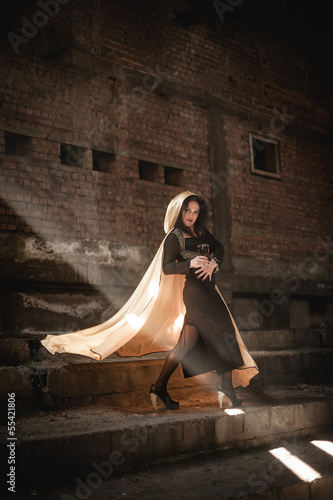 Posing woman with a white mantle