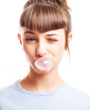 girl doing a bubble with a chewing gum on a white background