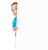cheerful child hidden behind a white banner