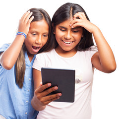 girls surprised using a tablet on a white background