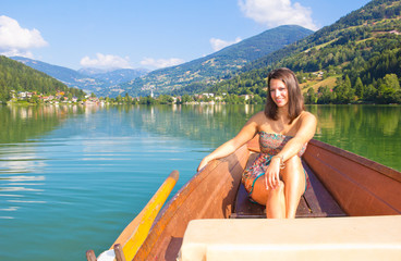 Young Woman In A Boat On The Lake