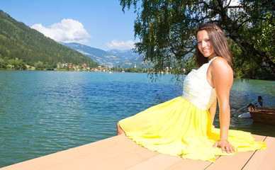 Young Woman In Yellow Dress At The Lake