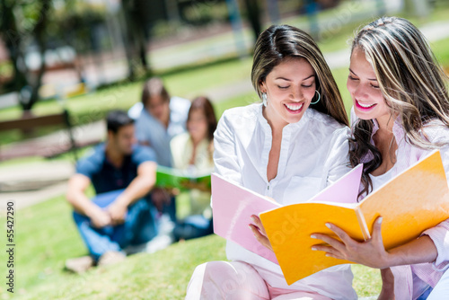 Girls studying outdoors