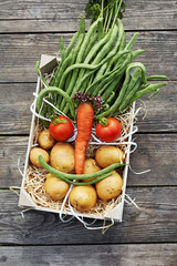 Fresh vegetables in a box, a face