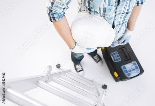 man with ladder, helmet and toolkit