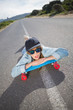 Funky young woman lying on a deserted road