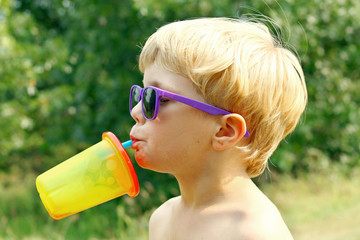 Child Drinking on Hot Summer Day