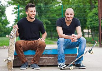 Skateboarder friends portrait at skatepark.