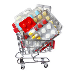 Colorful pills in shopping cart isolated. concept