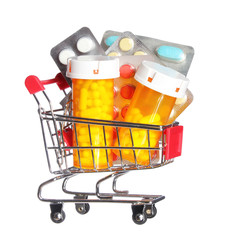 Pill bottle and pills in shopping cart isolated. Pharmacy