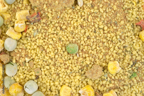 Close view of dry couscous, vegetables and seasoning