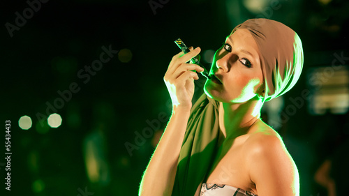 Sexy woman smoking electronic cigarette.