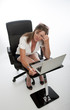 Stressed female office worker and computer