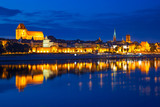Fototapety Torun old town at night reflected in the river, Poland