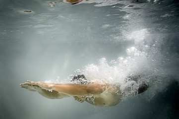 male pool diving