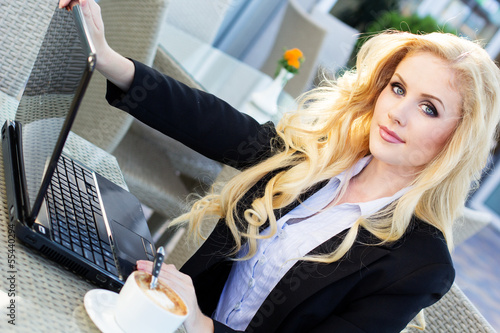 Young pretty business woman with notebook