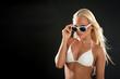 Beautiful blonde woman portrait with white bikini and sunglasses