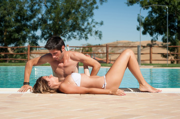 Portrait of a happy young couple in a swimming pool.