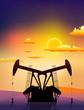 oil rigs on sunset landscape