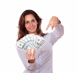 Attractive woman holding and pointing money