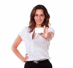 Beautiful hispanic woman holding blank card