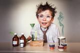 Crazy scientist. Young boy performing experiments