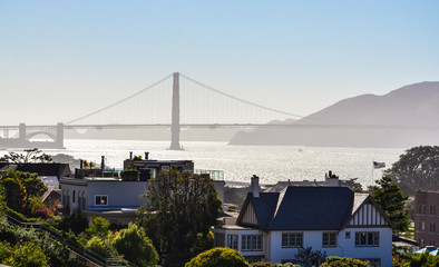 Silhouetted view of Golden Gate Bridge from Franklin Street in S