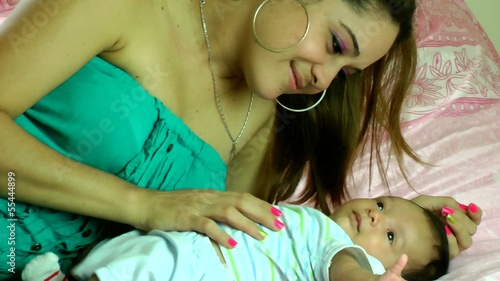 Hispanic mother playing with her baby infant
