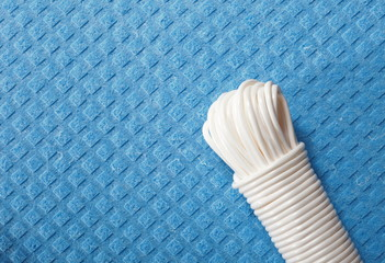 White plastic rope on blue background