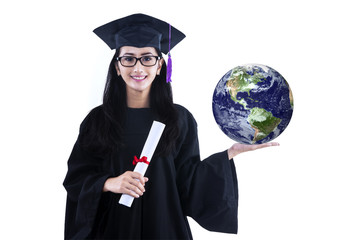 Beautiful female graduate holding earth - isolated