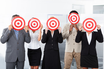 Businesspeople Holding Dartboard