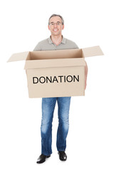 Happy man holding donation box