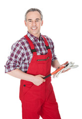 Mature Man Holding Wrench