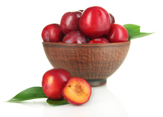 Ripe plums in bowl isolated on white