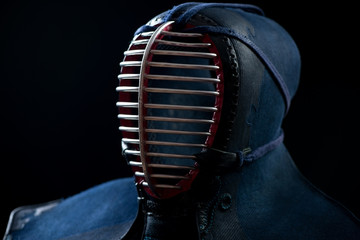 Men: kendo protective sportswear, over black background