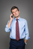 worried businessman is talking on the phone