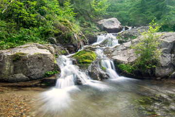 Waterfall in deep green forest in Transylvania