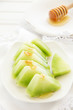 Appetizer of green watermelon with honey.