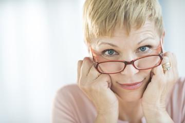 Woman Peering Over Her Eyeglasses