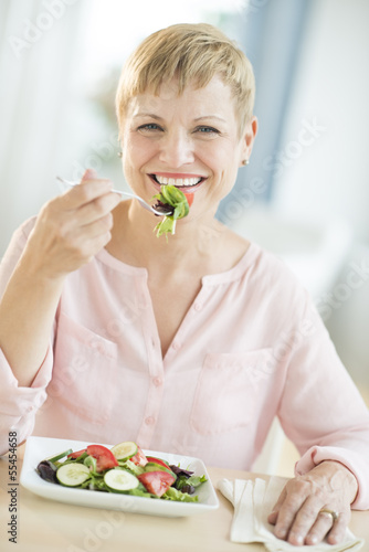 Happy Woman Eating Vegetable Salad