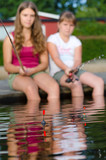 Girls focused on fishing floats