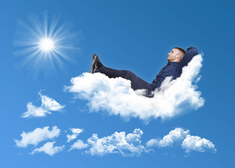 businessman relaxing on a cloud
