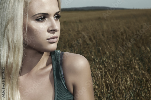 sad beautiful blond woman.gray.beauty girl.nature background