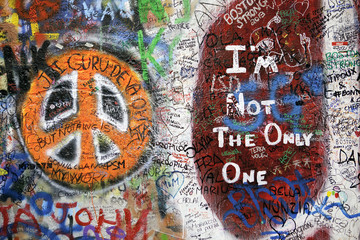 Colorful graffiti with modern art and peace symbol, Prague.
