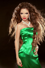 Fashion Beauty Girl with long brown blowing hair posing in elega