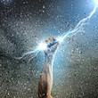 Human hand holding lightning - 55458026