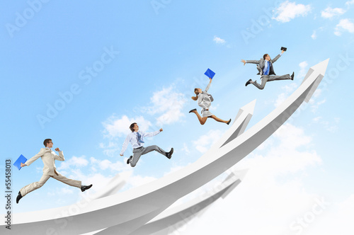 Businesspeople jumping