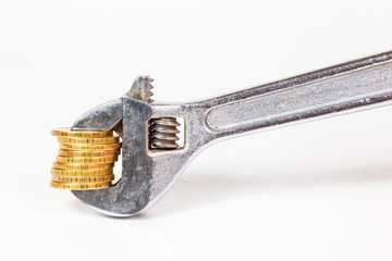 wrench and coins